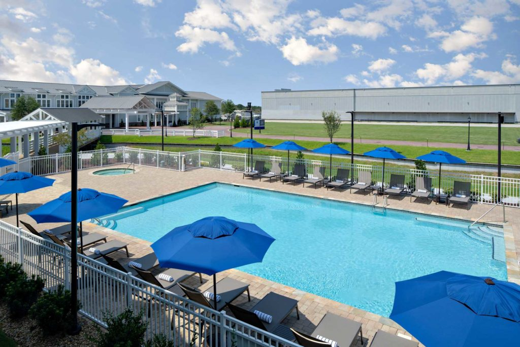 rendering of pool deck chaise chairs along the outdoor pool ledge