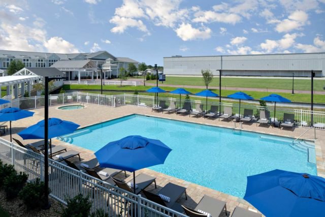 Pool deck chaise chairs along the outdoor pool ledge
