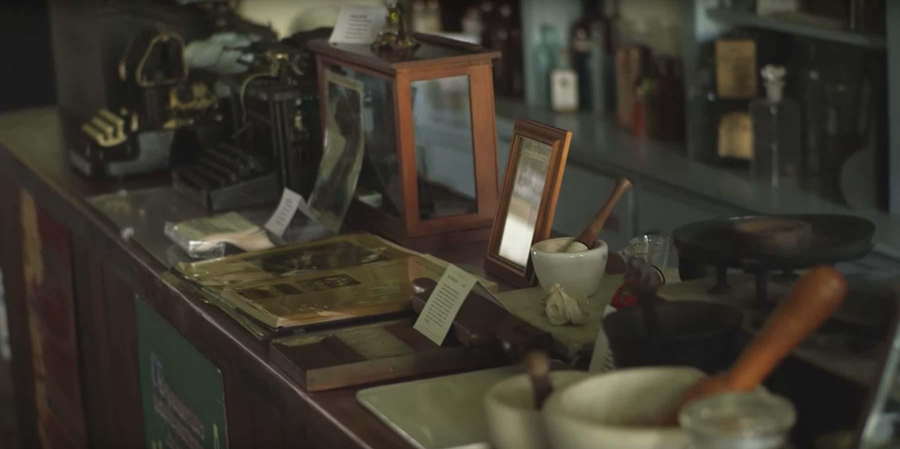 an old historic store front desk full of knick-knacks