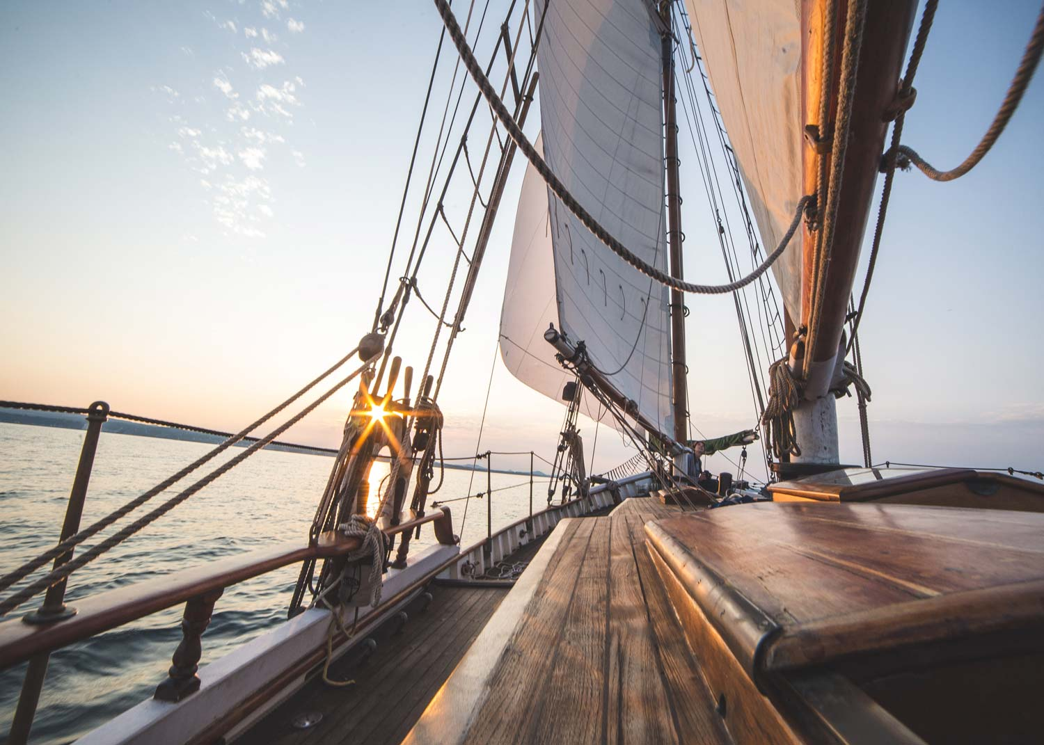 a close up of a sail boat on the ocean