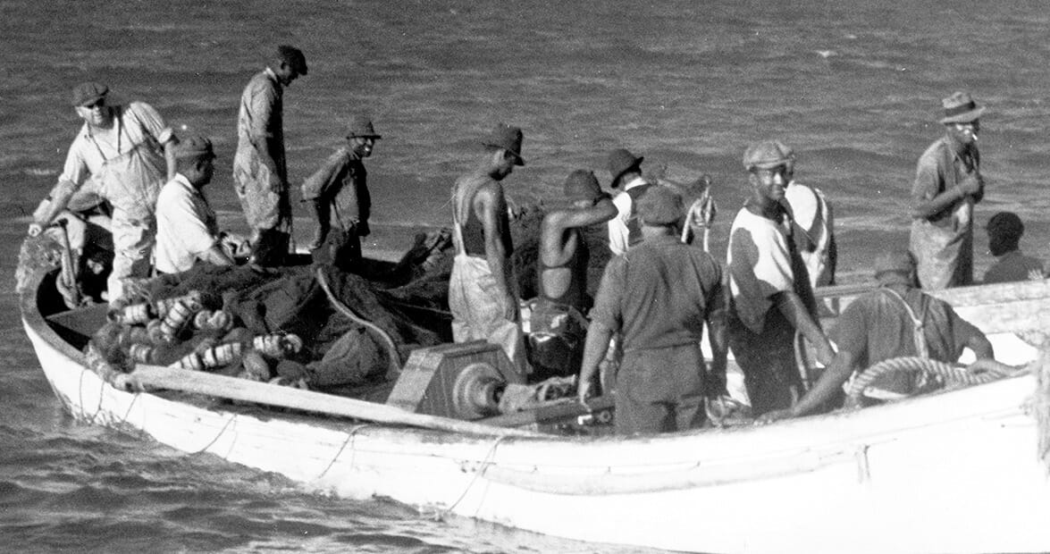 Old photo of men in a fishing boat