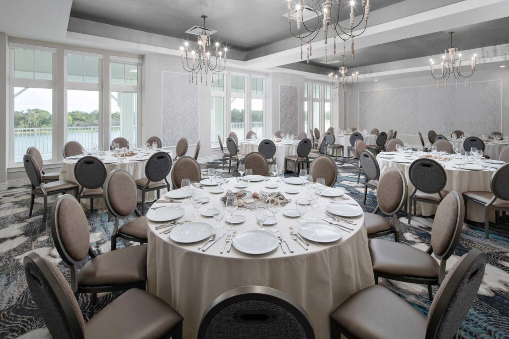 large ballroom venue with detailed round tables and place settings for a luxury event