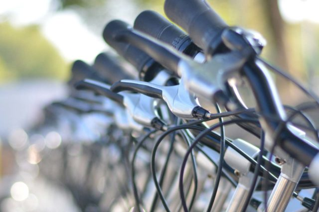 a row of bicycles available for rent
