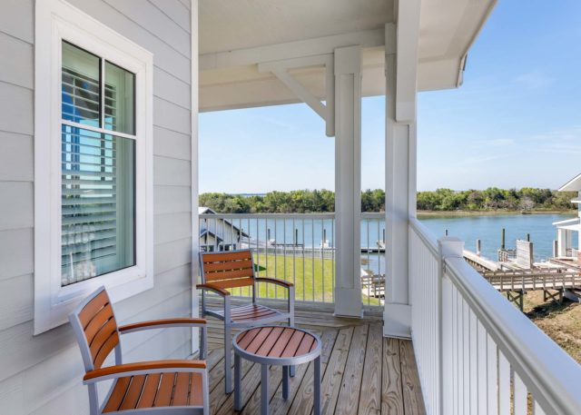 Outdoor patio from guest room overlooking the water's edge