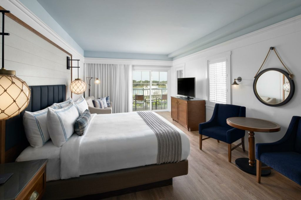 King waterview guest room with seating