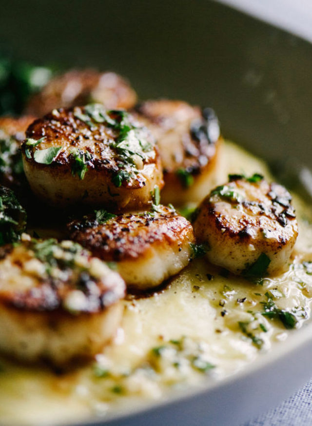 scallops fresh and crispy on a pan with garnish