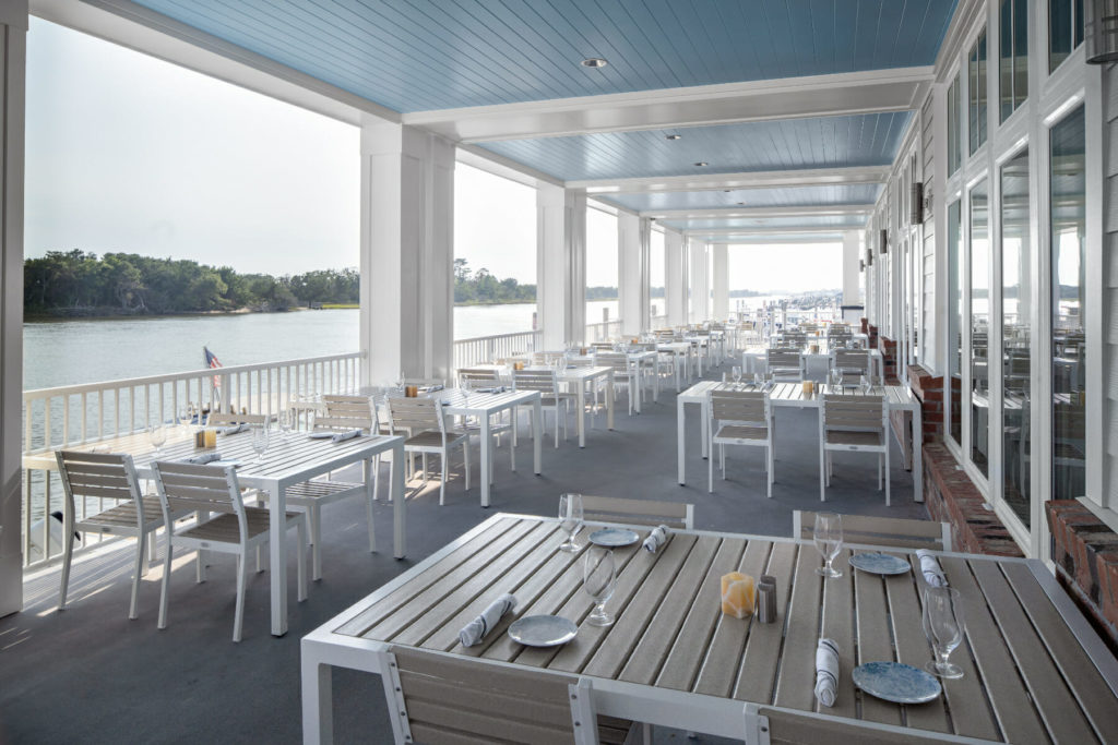outdoor dining patio beside lake