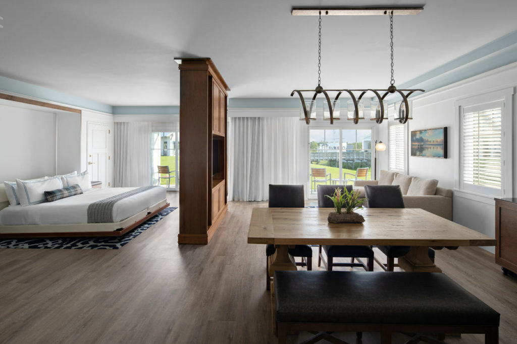 modern suite with bed dining table and living room