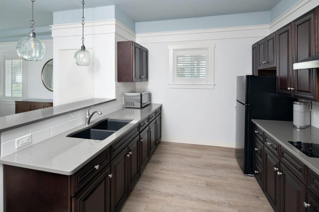 modern kitchen with dark wooden cabinetry