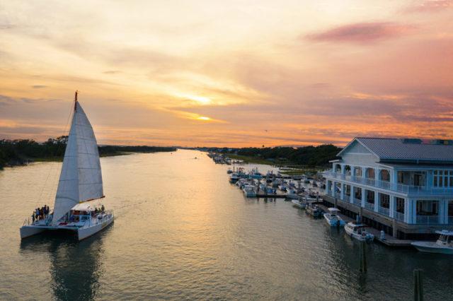 boat sailing on lake at sunset