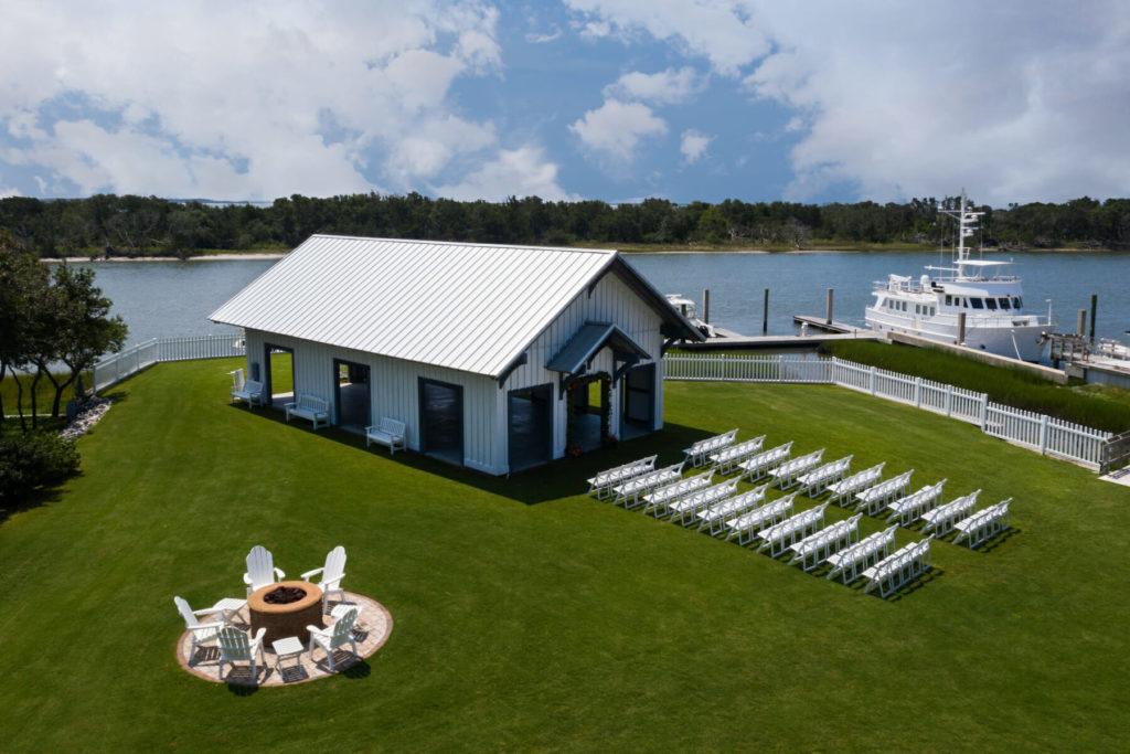 aerial view of outdoor wedding venue beside lake