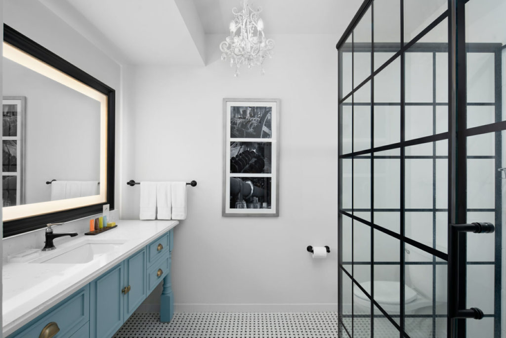 bathroom with large vanity, toilet, and stand up shower