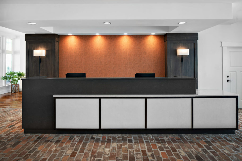 hotel lobby front desk with brick floor