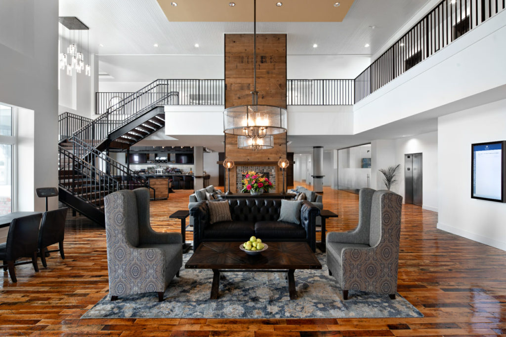 hotel lobby with seating areas and wooden floor