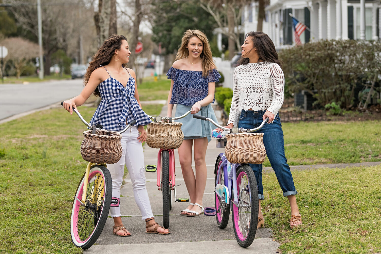 3 young ladies with bicycles chatting
