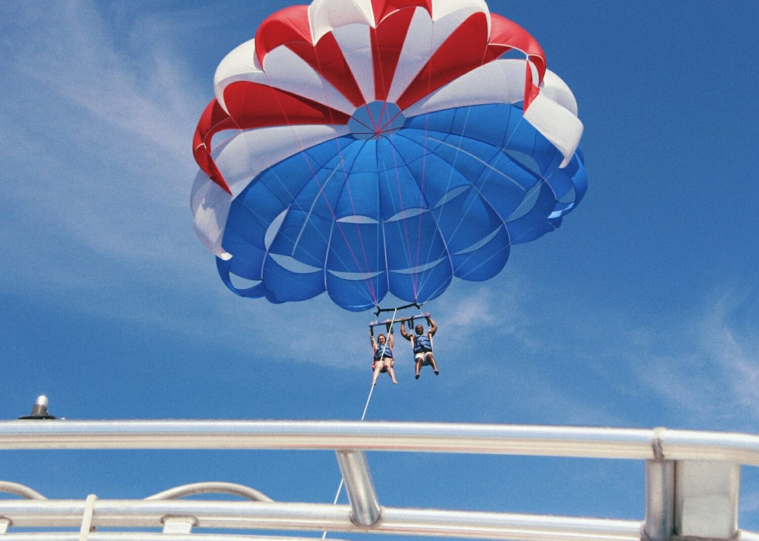 Parasailing couple flying in the sky