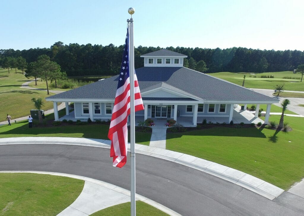 Beaufort Hotel's Clubhouse exterior with American Flag mounted outside