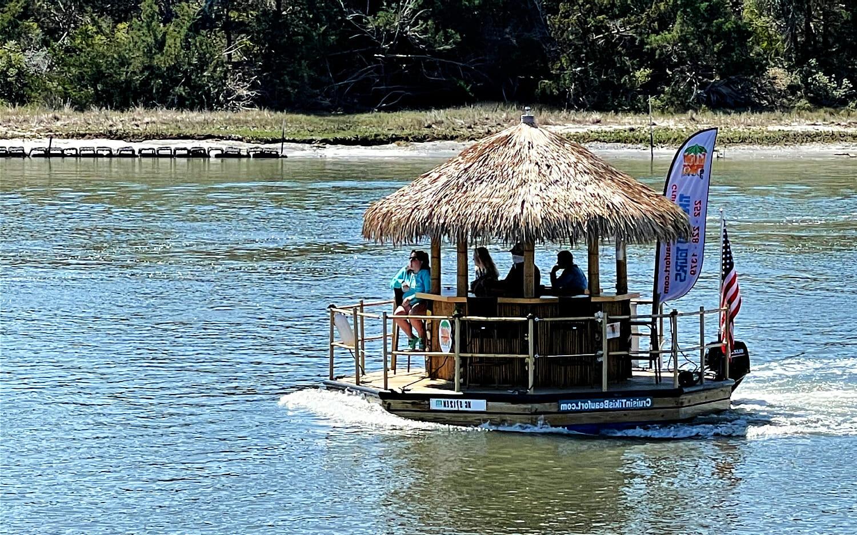 Tiki bar boat cruising on water