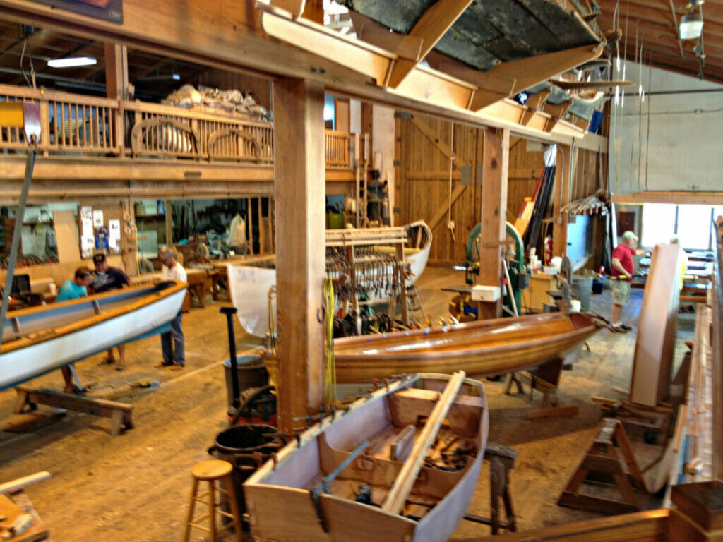 Interior or building with a collection of wooden boats